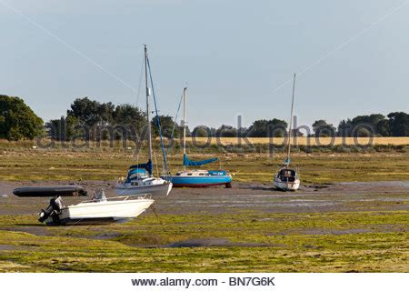 boat fishing in chichester harbour boats at low tide in chichester harbour at bosham west