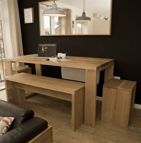 Solid oak dining room table, bench and stools.