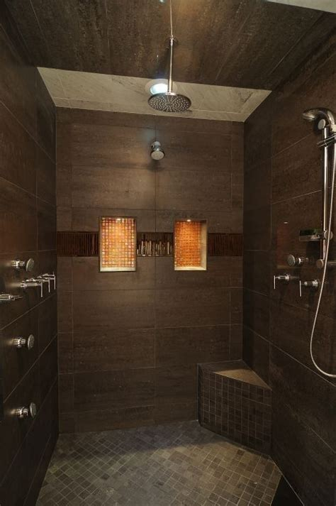 dark tile bathroom ideas dark brown shower with large tiles and glass accents