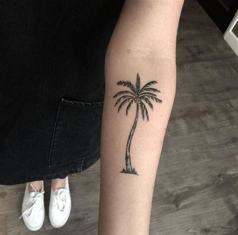 tiny palm tree tattoo thinking of adding a small patch of grass to my palm tree