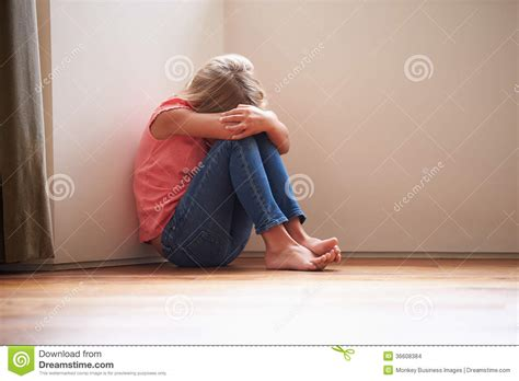 in home sitting unhappy child sitting on floor in corner at home stock images image 36608384