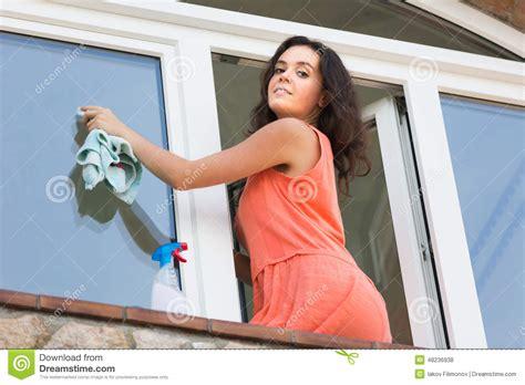 washing house windows young woman washing plastic windows in house stock photo image 48236938