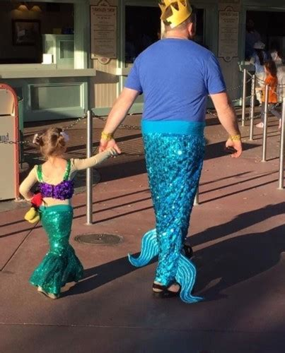 people  loving  dad dressed   mermaid