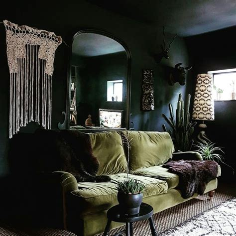 dark green couch living room i just want to curl up on this couch black walls and