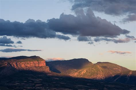 silhouette  hills  orange  yellow sky