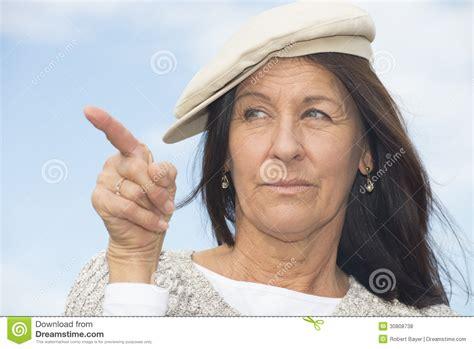 middle aged woman chignon portrait confident attractive mature woman royalty free