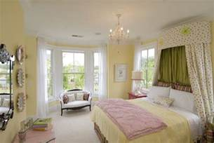 sunny yellow wall color with pink blanket for nice bedroom