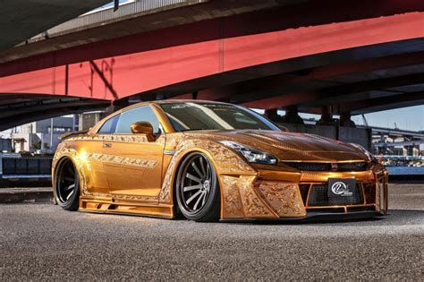 gold nissan car gold plated cars gold car