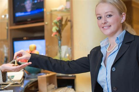 smiling receptionist handing room stock photo image 34369090