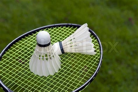 Shuttlecock Green Pro By Gs Sport two shuttlecocks on racket outdoors on green grass just