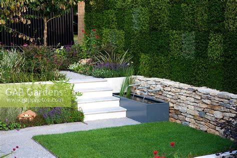 gap gardens split level garden with dry stone walling and heather on vertical wall image no