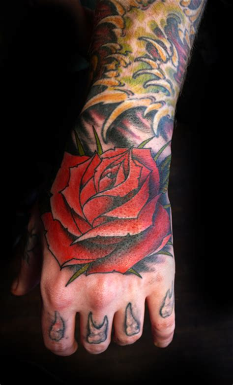 tattoo old school hand old school flower hand tattoo by saved tattoo
