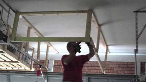 How To Build A Hanging Shelf In Garage by Unfinished Diy Overhead Garage Ceiling Storage Rack