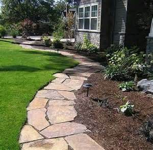 flagstone pathway for flowerbed edging garden