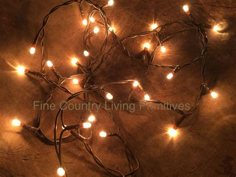 primitive string lights primitive country teeny rice string lights on