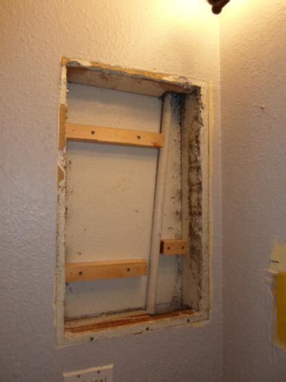 removing built in medicine cabinet ufo diy challenge medicine cabinet turned open shelving