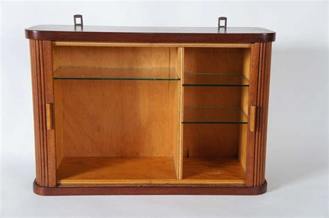 a small hanging cabinet with tambour doors at 1stdibs