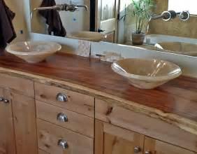 Onyx vessel sinks on natural edge wood slab vanity top