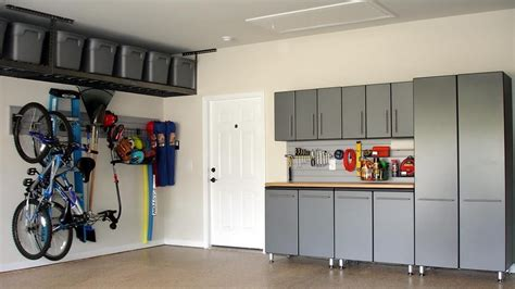 garage cabinets shelves ceiling racks this garage represents our ceiling to floor craftsmanship we install cabinets shelving