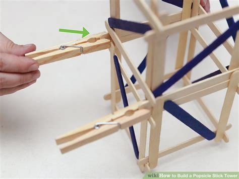 what can i use to stick pictures on my wall how to build a popsicle stick tower 14 steps with pictures