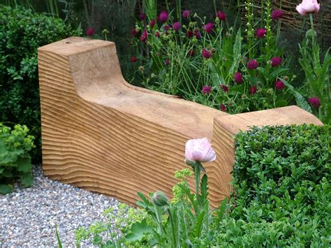 hardwood garden benches growing with plants garden bench round up