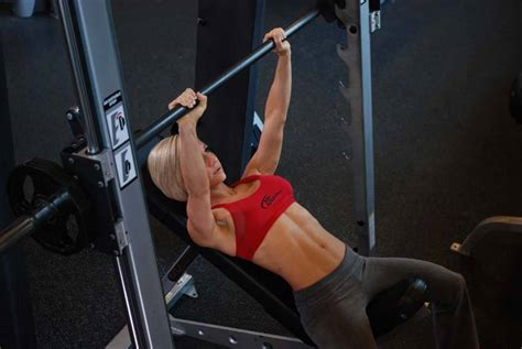 women bench pressing smith machine incline bench press exercise guide and video