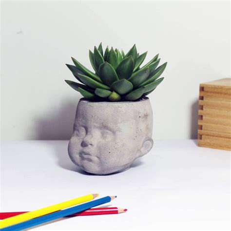 large head planters large concrete dolls head planter desk organizer