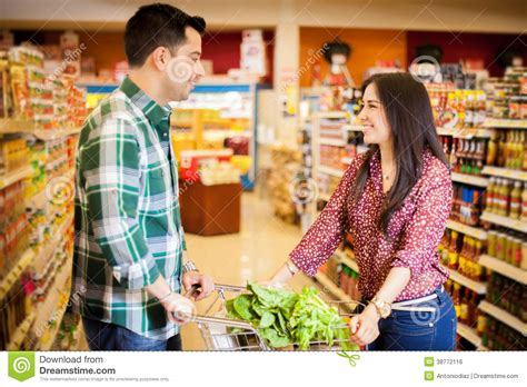 Shop Coules Flirting At The Grocery Store Stock Photo Image 38772116