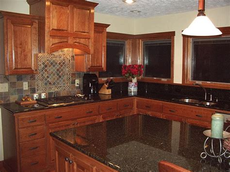 cherry wood kitchen cabinets with black granite want to have the best look of your kitchen use the