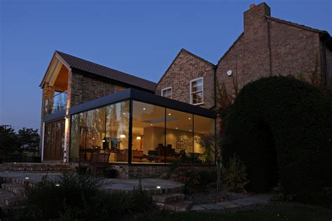 old modern modern glass addition to otherwise traditional home