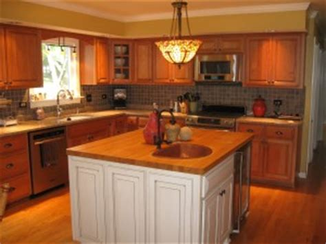 hide soffit above kitchen cabinets by adding crown molding removing kitchen soffits worth it kitchen craftsman