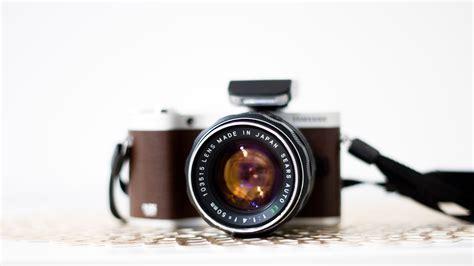 black  silver canon dslr camera  stock photo