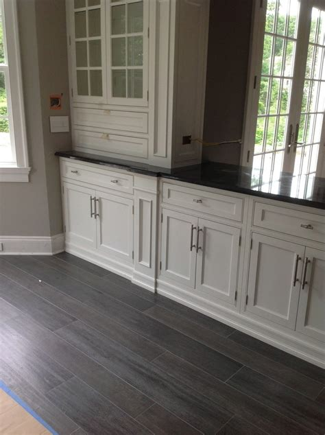 kitchen with grey floor grey wood flooring dining room contemporary with white