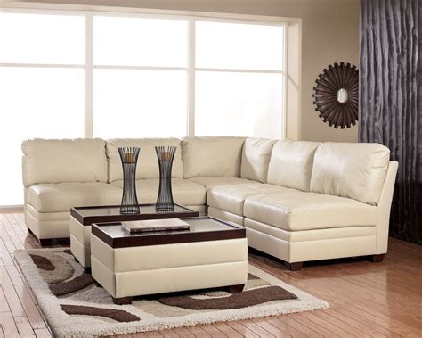ashley furniture leather sectional aero ivory modern sectional by ashley la furniture center