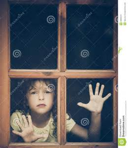 Unusual House Plans Sad Child Looking Out The Window Stock Photo Image 48992241