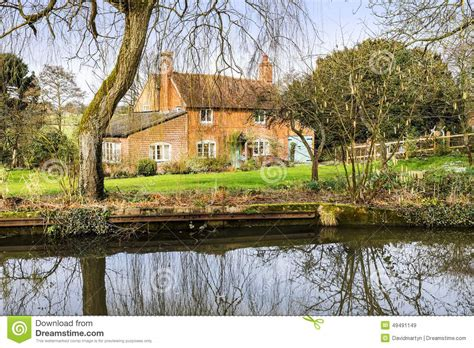 cottage next to water stock photo image 49491149
