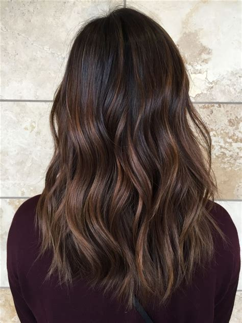 trendy to elegant black hair with caramel highlights trendy hair highlights caramel balayage on asian hair