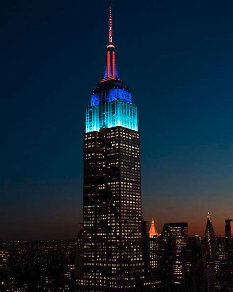 empire state building illuminates in and blue for