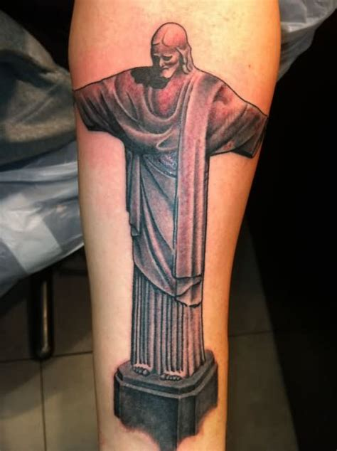 christ the redeemer tattoo on right half sleeve