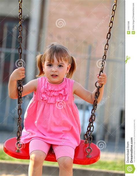 little girl on swing happy little girl on a swing royalty free stock photos