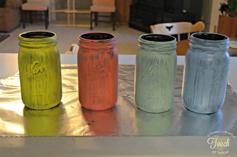 spray painting jars a s with a touch of yellow diy vintage