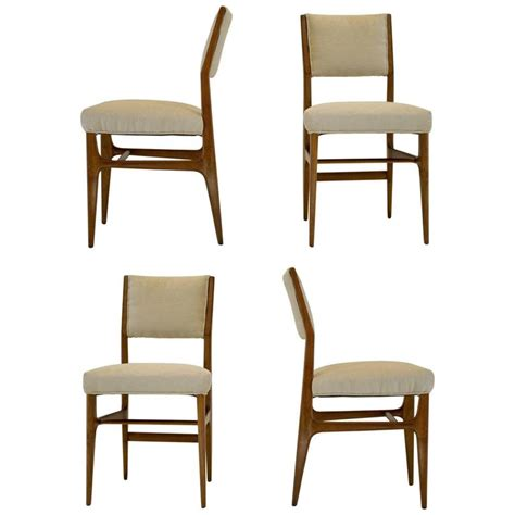 set of four walnut dining chairs by gio ponti m singer