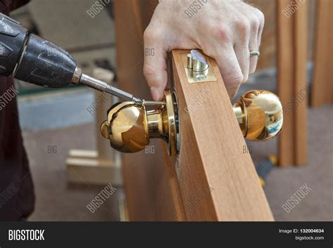 How To Tighten A Door Knob by Install The Door Handle With A Lock Carpenter Tighten The