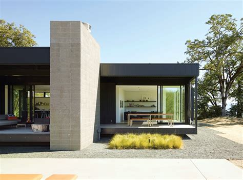 prefab house black white yellow a simple plan from dwell