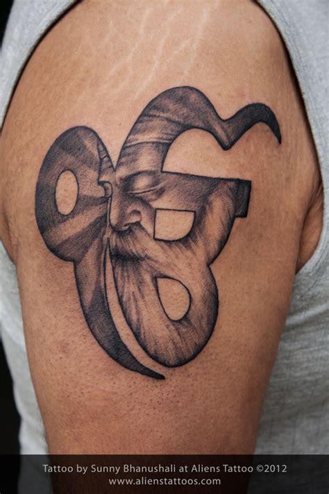 gurunanak devji in ek omkar tattoo inked by sunny at