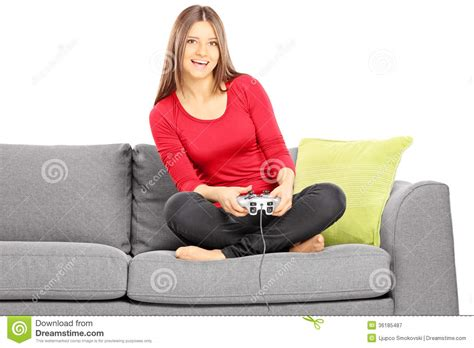 video game couch young smiling female sitting on a couch and playing video