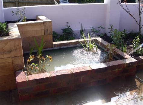 Raised Garden Pond Ideas Semi Raised Pond In Flower Bed Hove Garden Pond Raised Ponds Fountains Pinterest
