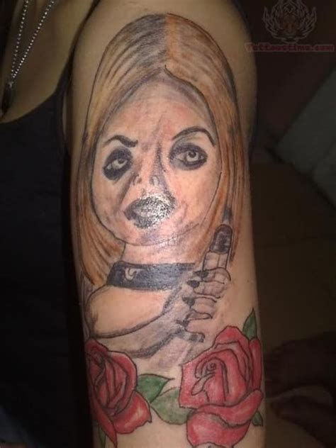 tattoo fail wife chucky wife and red roses tattoo on half sleeve