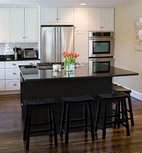 white kitchen black island black kitchen furniture and edgy details to inspire you