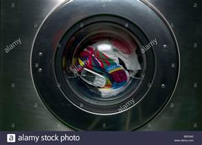 phone washing machine a mobile phone sits in the washing machine with a